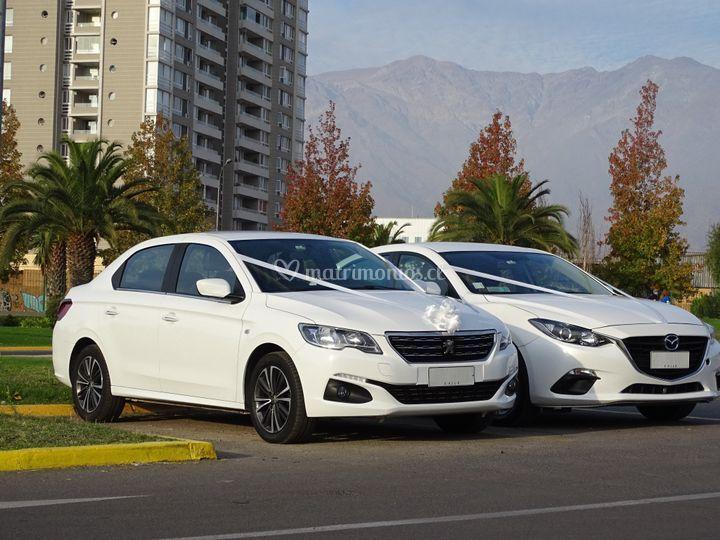 Peugeot 301 y Mazda 3