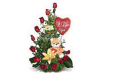 Caracola con rosas y lilium