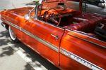 Carro naranja de Autos Antiguos