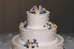 Torta blanca con flores